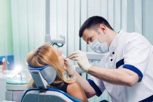 Woman having surgery for dental implants in Arlington.